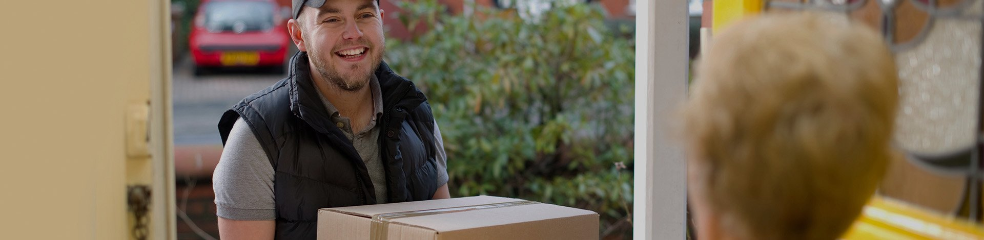 Man delivering box to house